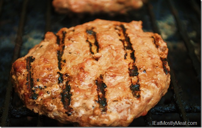 image grass fed burger on the gril;